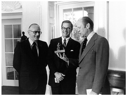 President Gerald Ford with a miniature Minute Man of Concord statue